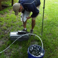 USGS scientist recording water-quality parameters