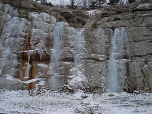 Frozen waterfall on an exposed bedrock outcrop.
