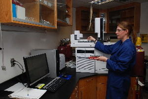 USGS scientist working with a gas chromatograph/mass spectrometer.