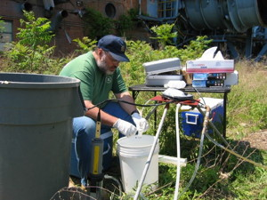 USGS scientist collecting water samples from a monitoring well.