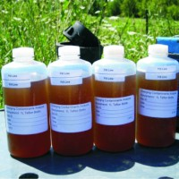 Four sample bottels filled with leachate