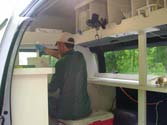 A look inside the mobile lab, where John is churning water samples.